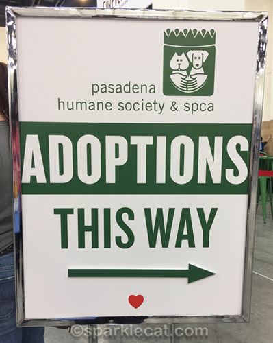 cat adoptions sign at CatCon