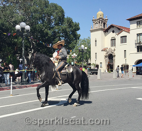 a horse with traditionally clad rider at Olvera Street