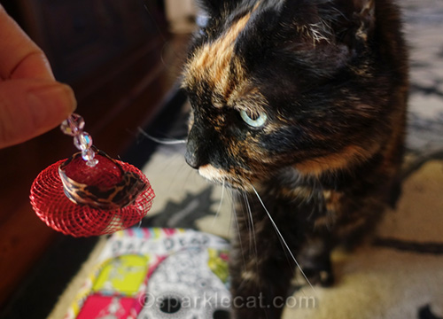 tortoiseshell cat with red hat ornament