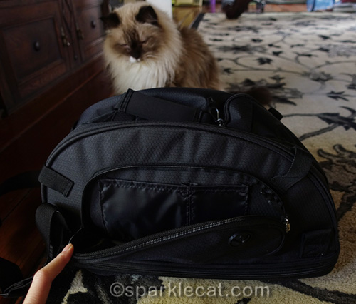 handy pocket on side of sherpa comfort ride pet carrier