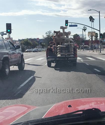 truck full of cat trees driving down street