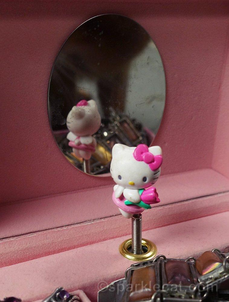 hello kitty figurine in jewelry box