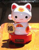 A solar-powered Mani Neko - Lucky Cat
