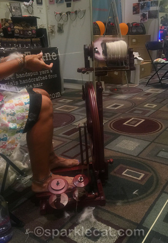 Spinning yarn at Nine Lives Twine booth