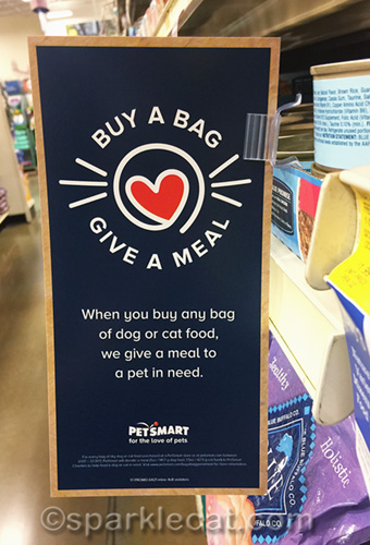 sign at Petsmart for the Buy a Bag Give a Meal program