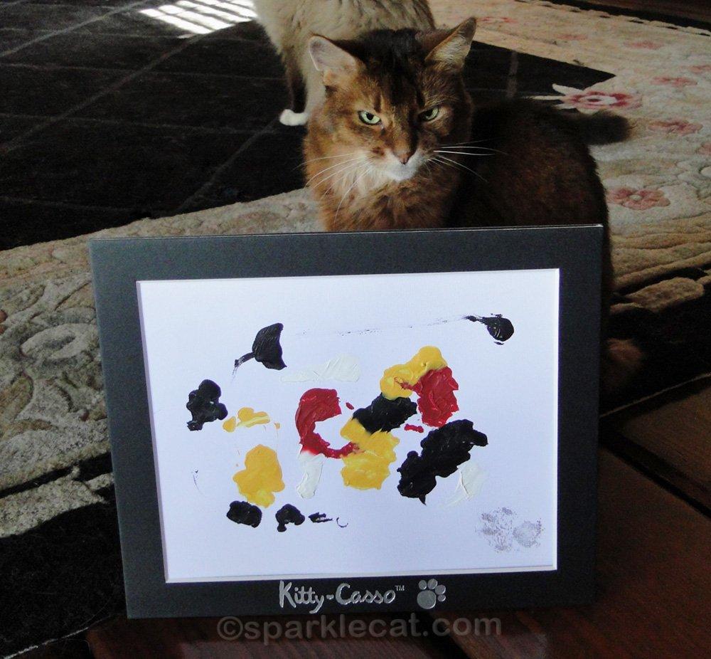 somali cat posing with cat art