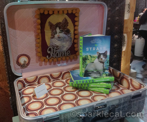 Strays book in cat bed suitcase