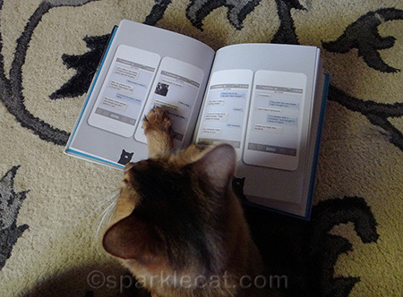 Yes, I use my paw to keep track of where I am on the page