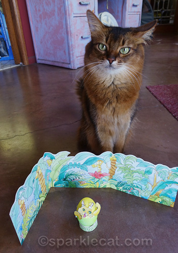 somali cat posing with decorated cat Easter egg