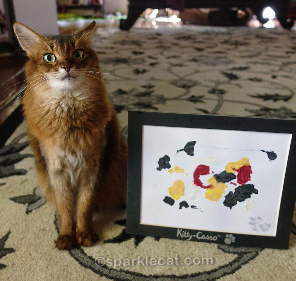Somali cat dubious about cat art signature